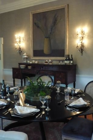 Traditional Dining Room with specialty door, Wall sconce, Crown molding, Wainscotting, Standard height, Hardwood floors