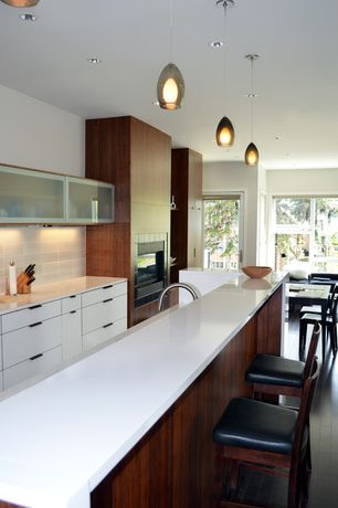 Contemporary Kitchen with Limestone Tile, Quartz counters, Stone Tile, Flush, Paint 1, built-in microwave, Pendant light