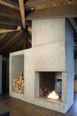 Contemporary Living Room with Custom Concrete Fireplace, Old Growth Hardwood Walnut Tavern Flooring