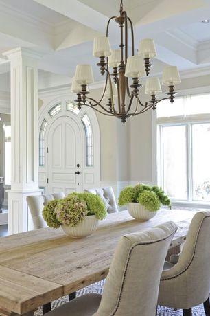 Traditional Dining Room with Hamilton Teak Dining Table, Safavieh Mercer Modern dining chair, Wainscotting, Columns, Carpet