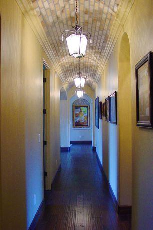 Mediterranean Hallway with Hardwood floors, Crown molding, flush light