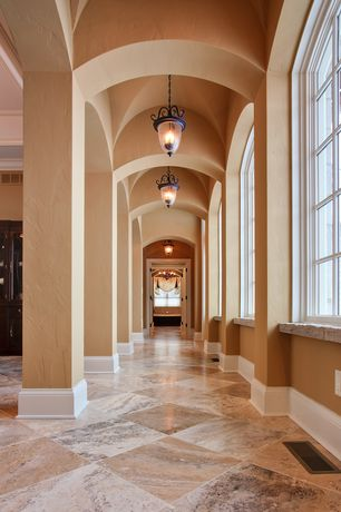 Mediterranean Hallway with Crema cappuccino polished, High ceiling, Columns, Concrete tile , Wainscotting, Pendant light