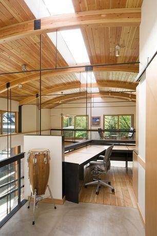 Modern Home Office with Hardwood floors, Exposed beam, Aeron chair - herman miller, High ceiling, Wood panel ceiling