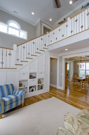 Cottage Staircase with Arched window, Built-in bookshelf, Cathedral ceiling, Hardwood floors, Exposed beam, Loft