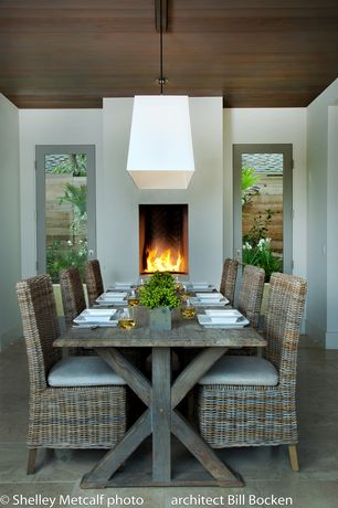 Contemporary Dining Room with Standard height, Fireplace, French doors, can lights, simple granite tile floors, Pendant light