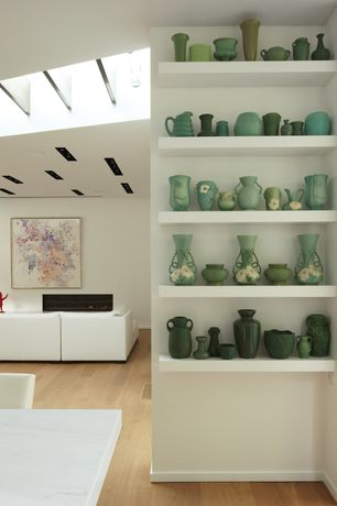Contemporary Dining Room with Antique green pottery, Green pottery vase collection, Skylights, Wood floors