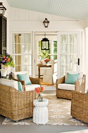Cottage Porch with exterior concrete tile floors, exterior tile floors, double-hung window, Screened porch, French doors