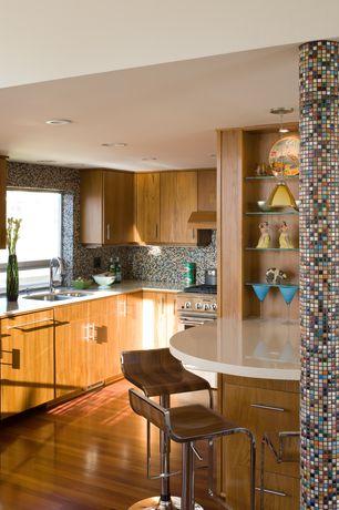 Modern Kitchen with Laminate floors, Dupont corian glacier white, Ceramic Tile, Ceramic tile mosaic, U-shaped, Flush, Column