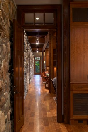 Rustic Hallway with can lights, Transom window, Hardwood floors, Built-in bookshelf, Exposed beam, French doors