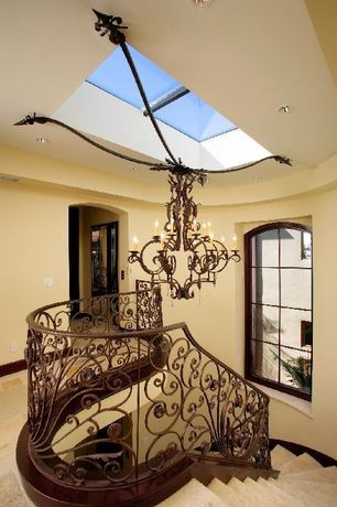 Mediterranean Staircase with Carpet, Skylight, Chandelier, High ceiling