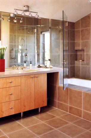 Contemporary Master Bathroom with Flush, flush light, frameless showerdoor, tiled wall showerbath, Undermount sink