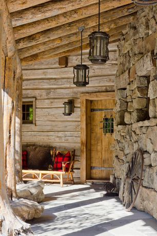 Country Front Door with exterior tile floors, Exposed beam, Natural stone wall