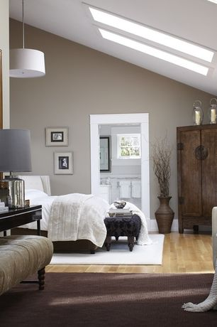 Traditional Master Bedroom with Cathedral ceiling, Laminate floors, Built-in bookshelf, Pendant light