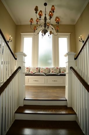 Traditional Staircase with Arched window, Double staircase, Window seat, Built-in bookshelf, Chandelier, Laminate floors