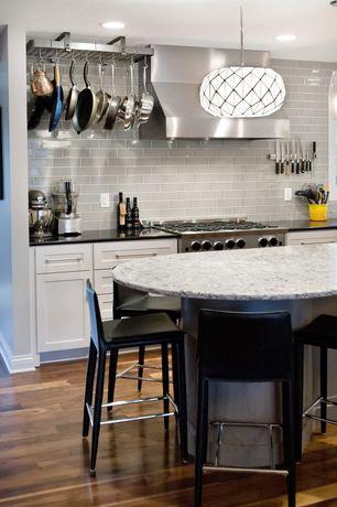 Contemporary Kitchen with GLENN Bar stool, black, chrome plated, Flush, Subway Tile, Soapstone counters, Pendant light