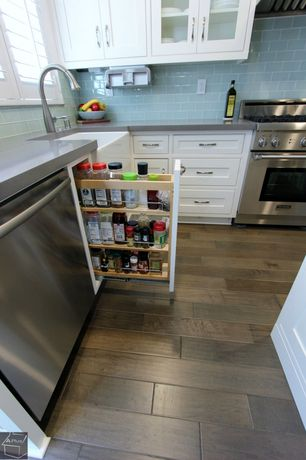 Cottage Kitchen with Custom cabinet shelving, Subway tiles, Wood tiled floor