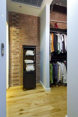 Eclectic Closet with can lights, interior brick, Standard height, Built-in bookshelf, Hardwood floors