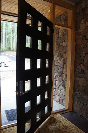 Contemporary Front Door with exterior tile floors, Glass panel door
