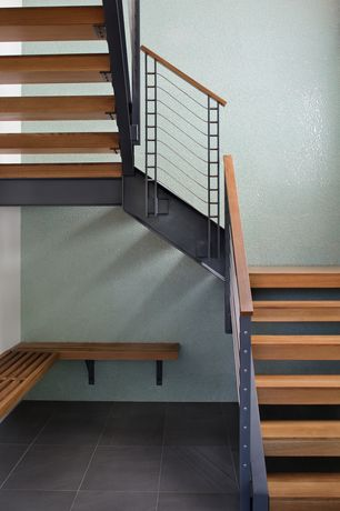 Contemporary Staircase with Cathedral ceiling, curved staircase, Concrete tile