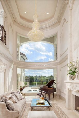 Mediterranean Living Room with Loft, picture window, Crown molding, Coffee table, Table lamp, Crystal chandelier, Grand piano