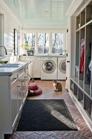 Cottage Laundry Room with Brick floors, Painted wood ceiling, Crown molding, Built in closet, Chicago common brick flooring