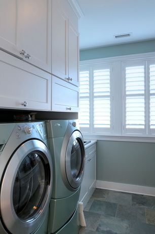 Traditional Laundry Room with Built-in bookshelf, laundry sink, travertine floors, Standard height, drop-in sink