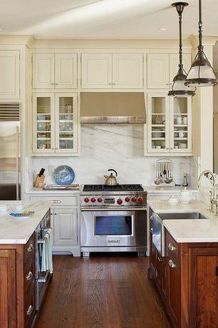 Craftsman Kitchen with Carrera bianco honed 16x16 floor and wall marble tile, full backsplash, gas range, Flat panel cabinets