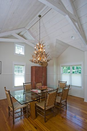 Craftsman Dining Room with Wainscotting, High ceiling, Adirondack three-tier chandelier, Hardwood floors, can lights, Paint