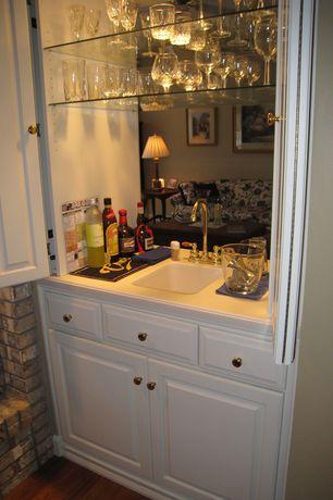 Traditional Bar with Built-in bookshelf, interior brick, Hardwood floors
