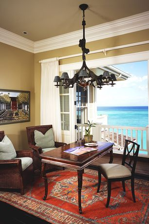 Tropical Home Office with Chandelier, French doors, Balcony, Crown molding, Rattan arm chair, Hardwood floors