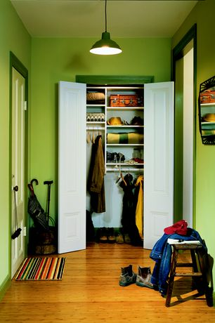 Modern Mud Room with six panel door, Standard height, Pendant light, Bamboo floors
