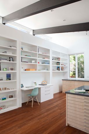 Contemporary Home Office with Built-in bookshelf, can lights, Hardwood floors, Casement, Exposed beam, Standard height