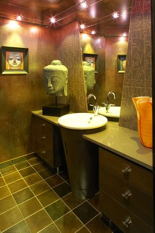 Modern Powder Room with Buddha head sculpture on base, Track lighting, European Cabinets, stone tile floors, Drop-in sink