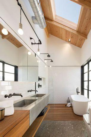 Modern Master Bathroom with Exposed beam, Skylight, Master bathroom, Wood counters, Double sink, Freestanding, Rain shower
