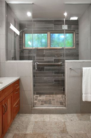 Craftsman 3/4 Bathroom with European Cabinets, Flat panel cabinets, Complex marble counters, Handheld showerhead, Flush
