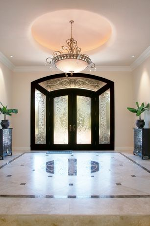 Traditional Entryway with Built-in bookshelf, Pental calacatta gold honed marble, can lights, Chandelier, Standard height