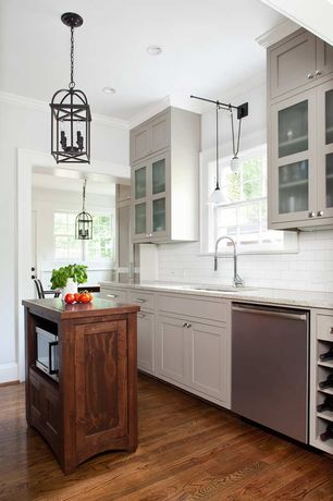 Cottage Kitchen with Pendant light, Casement, Wall sconce, can lights, Subway Tile, Kitchen island, Framed Partial Panel