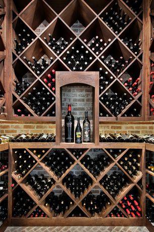 Traditional Wine Cellar with Built-in bookshelf, herringbone tile floors, Brick floors