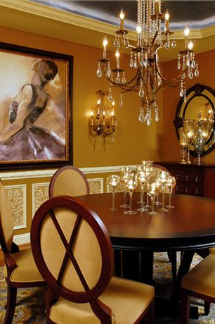 Traditional Dining Room with Wall sconce, Chandelier, Wainscotting, Chair rail, Crown molding, Hardwood floors