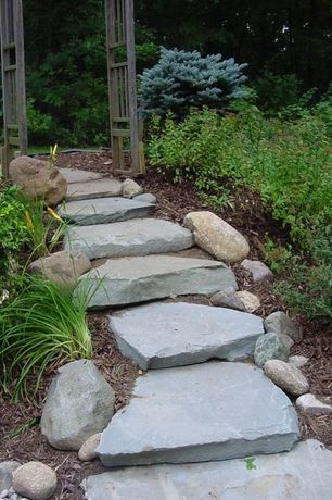 Rustic Landscape/Yard with Arbor, exterior stone floors, Pathway
