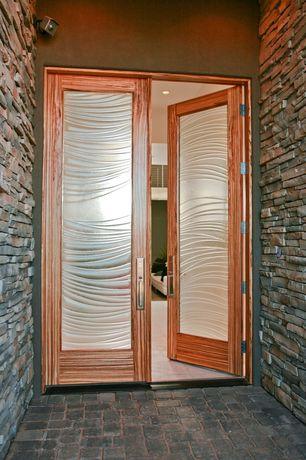 Modern Front Door with French doors, exterior stone floors
