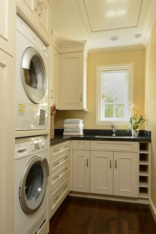 """Traditional Laundry Room with Bosch Ascenta Series WTB86200UC 24"""" Ventless Electric Dryer, Hardwood floors, Crown molding"""