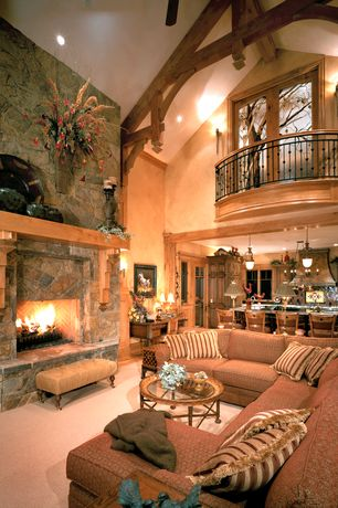 Rustic Great Room with Cathedral ceiling, Custom wrought iron railing, stone fireplace, French doors, Carpet, Wall sconce