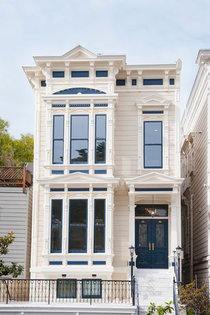 Traditional Exterior of Home with Transom window, double-hung window, Deck Railing, Glass panel door