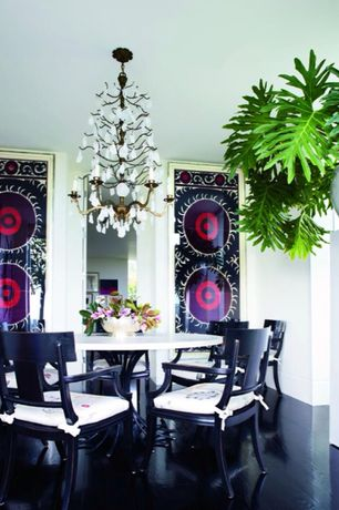 Contemporary Dining Room with Chandelier, Laminate floors