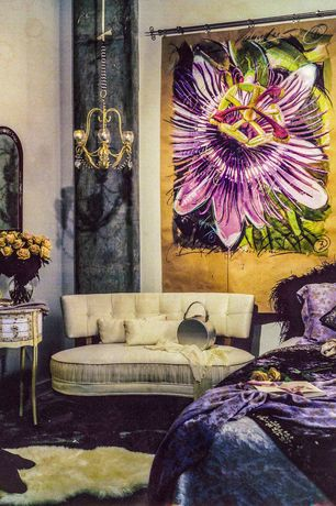 Eclectic Guest Bedroom with Pattern Of Ornate Floral Tapestry, Concrete floors, Chandelier, Paint, Standard height