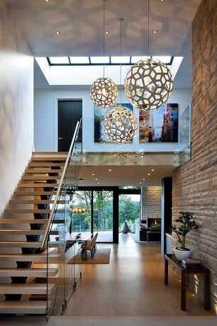 Contemporary Entryway with Glass railing, Custom Floating Stairs With Concrete Support And Glass Railing, Built-in bookshelf