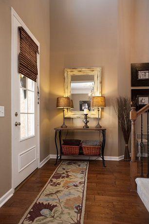 Eclectic Entryway with Glass panel door, High ceiling, Hardwood floors