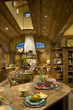 Country Kitchen with picture window, Chandelier, gas range, Arched window, Msi chestnut brown limestone countertop, Wall Hood