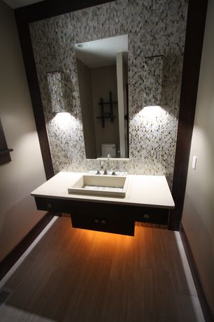 Contemporary Powder Room with Standard height, Wall-hung vanity, Corian counters, Powder room, can lights, European Cabinets